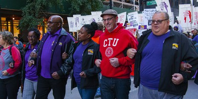 Chicago Teachers Union Members March At A Rally