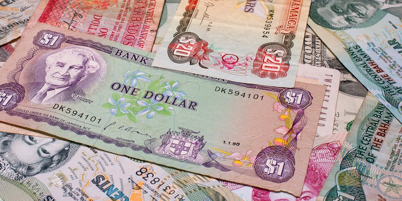 A scattering of money from various Caribbean countries.