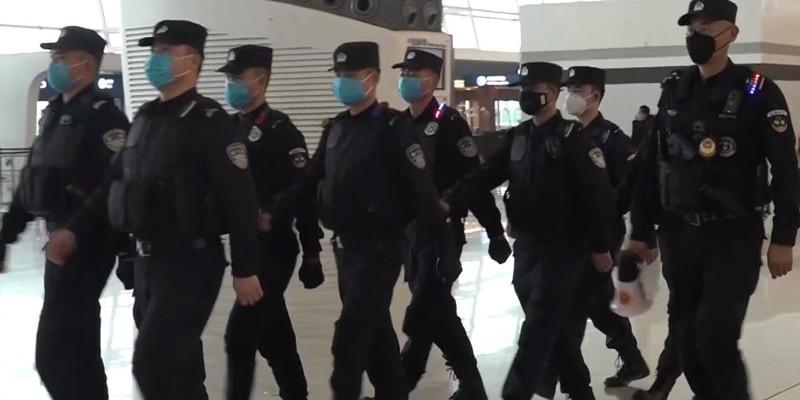 Wuhan Policemen Patrol Airport